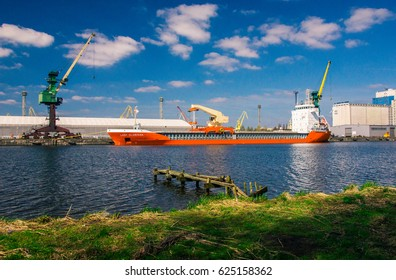 SZCZECIN, POLAND - APRIL 9, 2017: A cargo ship offloading in Polish seaport and deep water harbour in Szczecin.