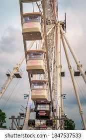 Szczecin, Poland, June 2019 Closeup on gondolas of illuminated, 80 meter tall cantilevered observation wheel in amusement and theme park