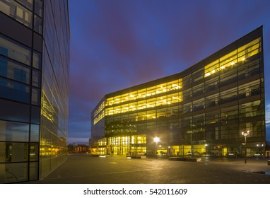 SZCZECIN, POLAND-CIRCA NOVEMBER 2016:Office building with glass facade,Modern office building in the evening