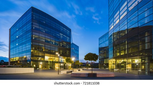 Szczecin, Poland-September 2017: Building of glass and metal office building at sunset, sky reflecting from glass walls
