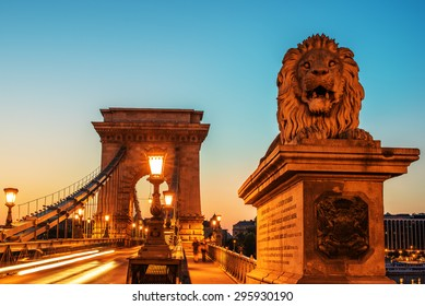 The Szechenyi Chain Bridge in Budapest, Hungary in the nice beautiful sunrise of the summer. One of most representative landmarks of Hungarian capital city.