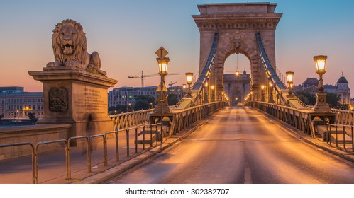 The Szechenyi Chain Bridge (Budapest, Hungary) in the sunrise. One of most representative landmarks of beautiful Hungarian capital city.