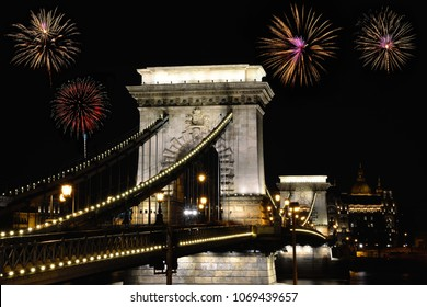 Szechenyi Chain bridge with fireworks, Budapest city, Hungary.