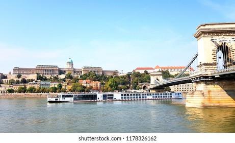 Szechenyi Chain Bridge lanchid Budapest and buda castle cruise boat on Danube