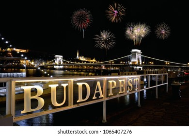 Szechenyi Chain bridge over Danube river with fireworks on Budapest city, Hungary.