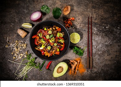 Szechuan beef asian food background with various ingredients on rustic stone background , top view. Vietnam or Thai cuisine.