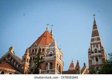 Szeged cathedral seen from the bottom in the end of afternoon, in summer. This cathedral (Szegedi Dom) is one of the symbols of Szeged, one of the biggest cities of southern Hungary. - Shutterstock ID 1978581845