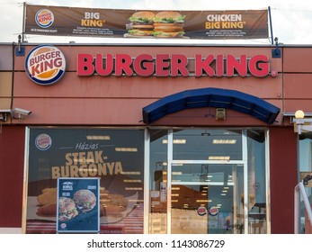 SZEGED, HUNGARY - JULY 3, 2018: Burger King logo on their main fast food restaurant in Szeged. burger King is a fast food restaurant brand and franchise spread worldwide