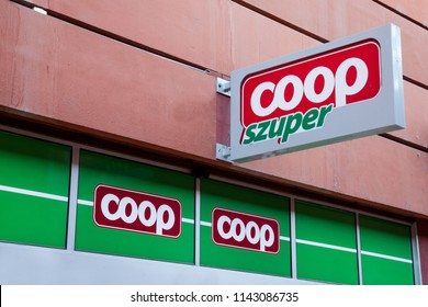 SZEGED, HUNGARY - JULY 3, 2018: Coop Szuper logo on their main supermaket in Szeged. Coop is a hungarian supermarket, groceries and general merchandise retailer