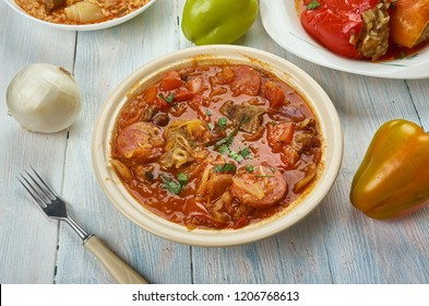Szekelygulyas , Hungarian Goulash with Pork and Sauerkraut, Hungarian  cuisine,  Traditional assorted dishes, Top view.