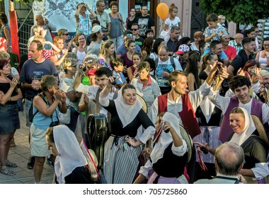 SZEKESFEHERVAR,HUNGARY - AUGUST 13. 2017 : 22th Royal Days International Folk Dance Festival organized annually in Székesfehérvár, Hungary.Majorca dancers on the main street parade.