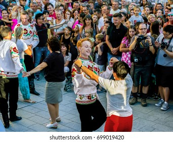 SZEKESFEHERVAR,HUNGARY-13.JULY, 2017 :The 22th Royal Days International Folk Dance Festival in Székesfehérvár.The dancers and spectators on the opening day ceremony on the main street.Siberian dancers