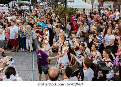 SZEKESFEHERVAR,HUNGARY-13.JULY, 2017 :The 22th Royal Days International Folk Dance Festival in Székesfehérvár.The dancers and spectators on the opening day ceremony on the main street.Siberian dancers