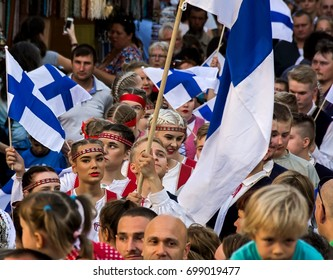 SZEKESFEHERVAR,HUNGARY-13.JULY, 2017 :The 22th Royal Days International Folk Dance Festival in Székesfehérvár.The dancers and spectators on the opening day ceremony on the main street.Finnish dancers.