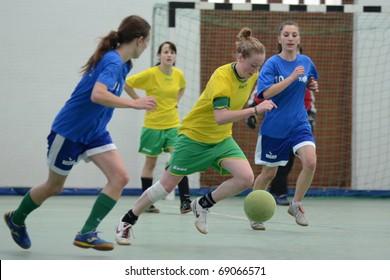 SZENNA, HUNGARY - JANUARY 15: Unidentified players in action at a Somogy Sporja Girl Futsal Competition match between Fonyod and Kaposvar University January 15, 2011 in Szenna, Hungary.