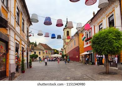 SZENTENDRE, HUNGARY - JUNE 29, 2018: Typical cobbled street of charming little town Szentendre, near Budapest, Hungary.