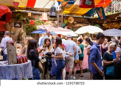 Szimpla Market, Budapest, Central Hungary, Hungary - 09/09/2018: A crowded farmer's market that takes place every Sunday in Szimpla Kert.