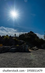 Szklarska Poreba, Poland - June 3 2020: Shining sun over hills and stones at Wysoki Kamien mountain