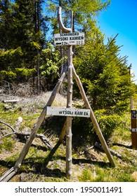Szklarska Poreba, Poland - June 3 2020: Road sign at mountain trail with direction to peak of Wysoki Kamien mountain