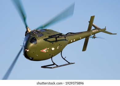 Szolnok, Hungary - August 20, 2019: Hungarian Air Force Airbus Helicopters Eurocopter AS350 H125M Ecureuil 102 military helicopter flying over Szolnok city downtown