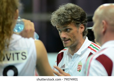 SZOMBATHELY, HUNGARY - JUNE 3: Zoltan Jokay (C) hungarian teams trainer in action at a CEV European League woman's volleyball game Hungary vs Bulgaria on June 3, 2011 in Szombathely, Hungary.