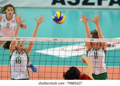 SZOMBATHELY, HUNGARY - JUNE 4: Unidentified players in action at a CEV European League woman's volleyball game Hungary vs Bulgaria on June 4, 2011 in Szombathely, Hungary.