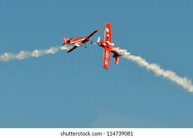 """SZYMANOW, POLAND - AUGUST 25: Aerobatic group formation """"Zelazny"""" at blue sky during during an air shows """"Air picnic"""", on August 25, 2012 in Szymanow, Poland."""