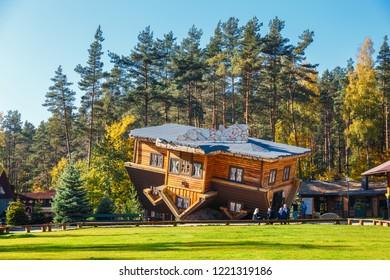 Szymbark, Poland - October 12, 2018: Exterior of wooden upside down house in Szymbark village
