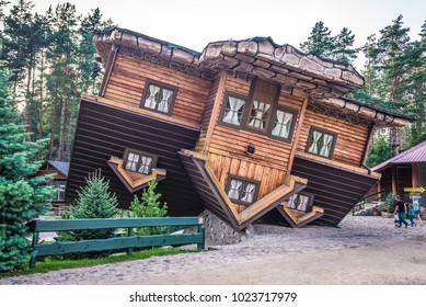 Szymbark, Poland - September 10, 2016: Exterior of wooden upside down house in open air museum in Szymbark village