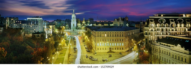 t beautiful views of the capital of Ukraine, view from the bell tower at St. Michael's Cathedral in front of Hagia Sophia. The sun painted the sky pink and purple of the capital, the city of lights