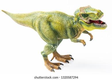 T rex figurine on white background