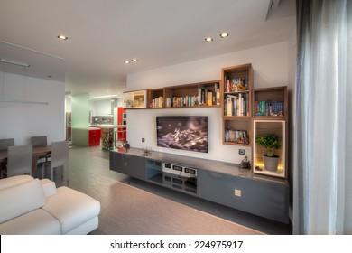 TA L'IBRAG, MALTA - SEPTEMBER 09, 2014: Modern, wall hung, TV shelving unit in a modern apartment in Ta L'Ibrag, Malta.