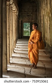 Ta Prohm temple, Siem Reap, Cambodia - October 29, 2017 : Monk walking in the alley