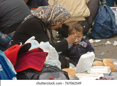 TABANOVCE, MACEDONIA: SEPTEMBER 29, 2015: Immigrants and refugees from Middle East and North Africa receive assistance in food and clothing at the Serbian Macedonian border.