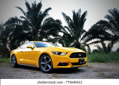 Tabasco, Mexico - May 22, 2017: Yellow supercar Ford Mustang at the countryside.