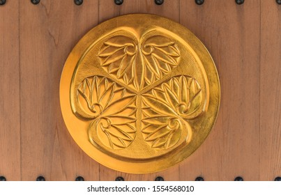 Tabata, Japan - January 03 2019: Golden coat of arms of the Shogun clan Tokugawa of ancient capital Edo which symbolizes three leaves of hollyhocks.