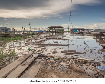 Tabatinga, Brazil - Dec 09, 2017: Pollution in the port of Amazon river, during the low water.