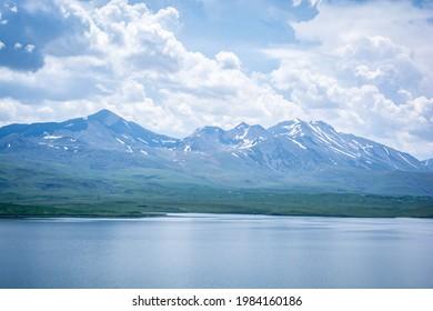 Tabatskuri lake in country Georgia, Samtskhe-Javakheti region. Beautiful and amazing alpine lake in georgia, with village Tabatskuri