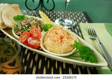 Tabbouleh with hommus and lemon chick peas with fresh pita bread.