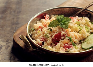 Tabbouleh Salad - Popular vegetarian Mediterranean dish made of fresh cucumber,tomatoes,parsley and coucous