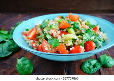 Tabbouleh salad with quinoa in bowl on vintage wooden table