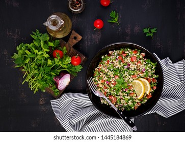 Tabbouleh salad. Traditional middle eastern or arab dish. Levantine vegetarian salad with parsley, mint, bulgur, tomato. Top view