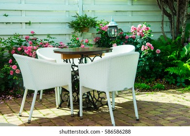 a tabel with chairs at the reargarden