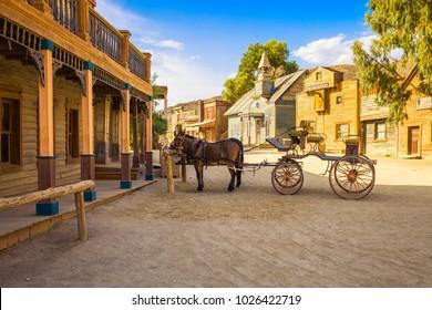 TABERNAS DESERT, ALMERIA ANDALUSIA / SPAIN - SEPTEMBER 18, 2011: Spaghetti western movie location set in Tabernas desert, horse drawn carriage.