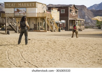 TABERNAS DESERT, ALMERIA, SPAIN - September 19, 2014: filming cowboy duel for a western movie. Wild west town set.