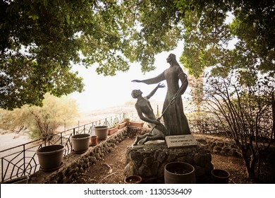 Tabgha, Israel - December 20 2017: The sculptures of Jesus and Peter at Church of the Primacy of St. Peter in Tabgha by the Sea of Galilee, Israel.
