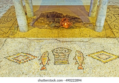 TABGHA, ISRAEL - FEBRUARY 22, 2016: The mosaic floor of the Multiplication Church, depicts the fishes and basket with loaves, which Jesus fed five thousand people, on February 22 in Tabgha.