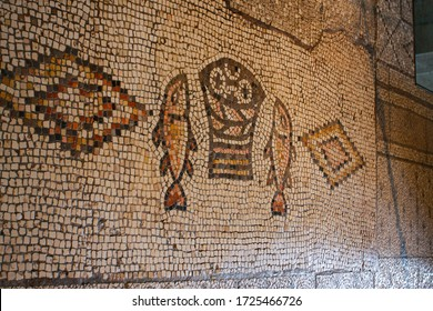 Tabha, Israel, August 2008. Ancient mosaic, image of two fish and five loaves. Church of the Multiplication of Bread and Fish (Tabha) The concept is the history of Christianity.
