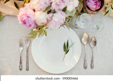 table appointments with flower composition and ivy