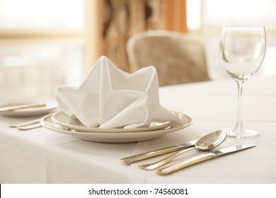 Table arrangement in an expensive haute cuisine restaurant